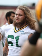 Green Bay Packers offensive lineman  Cole Madison (61) takes part in an OTA last spring.