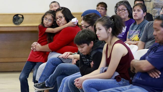 Kynareth Longoria, 7, left, and Letitia Buck, second from left, and other family members mourn for Ashlynne Mike during a vigil for her at the Nenahnezad Chapter House., on Wednesday, May 4, 2016, in Fruitland, N.M. Tom Begaye Jr. was arrested later Tuesday in the death of 11-year-old Ashlynne Mike. He made his first appearance Wednesday before a federal magistrate in Farmington.