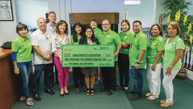 Pay-Less Supermarkets donates $1500 to Guam Diabetes Association for their 18th Annual Conference at the Hilton Guam Resort & Spa on Nov. 12. Pictured are members of the Guam Diabetes Association and Pay-Less Markets Management.