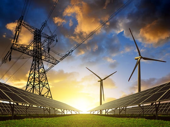 Wind turbines, an electrical transmission tower, solar panels, and the sun in a composite illustration.