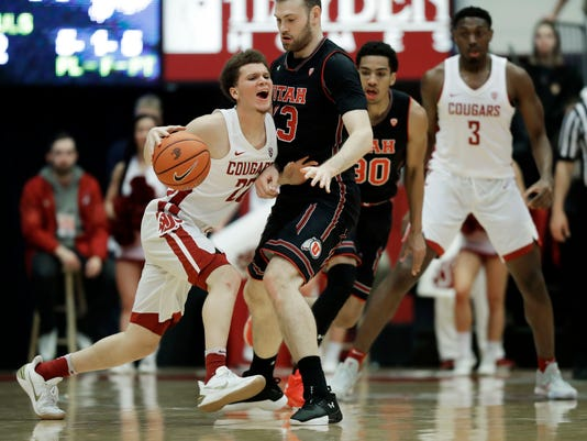 Washington State guard Malachi Flynn, left, is stopped by Utah forward David Collette, second from left, during the first half of an NCAA college basketball game Saturday, Feb. 17, 2018, in Pullman, Wash. (AP Photo/Ted S. Warren)