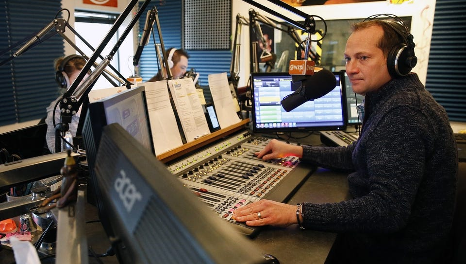 Dave Smiley, right, runs the morning show at WZPL-FM