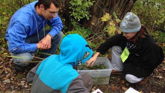 Paul Skawinski, AIS education specialist for Golden Sands Resource Conservation and Development Council Inc., teaches students to identify various aquatic plants Oct. 3 during the Waupaca County Conservation Field Day at Hartman Creek State Park.