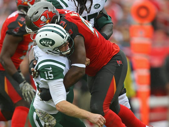 New York Jets quarterback Josh McCown is tackled by Tampa Bay Buccaneers defensive tackle Gerald McCoy in the first half at Raymond James Stadium.