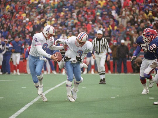 Houston Oilers kicker Al Del Greco (3) and holder Greg Montgomery (9) juggle the ball after an aborted field goal attempt during the fourth quarter of their game against the Buffalo Bills in January 1993 at Rich Stadium in Orchard Park, N.Y.  The field goal would have been the margin of victory, avoiding the overtime period. The Bills won the game in overtime 41-38.