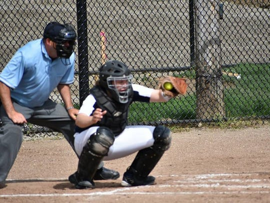 Expertly framing a pitch for Schoolcraft is catcher Victoria Porter, an alum of Canton High School.