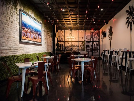 A large photo of Venice Beach covers California Cold Co's front window to give customers the ultimate Southern California experience.
