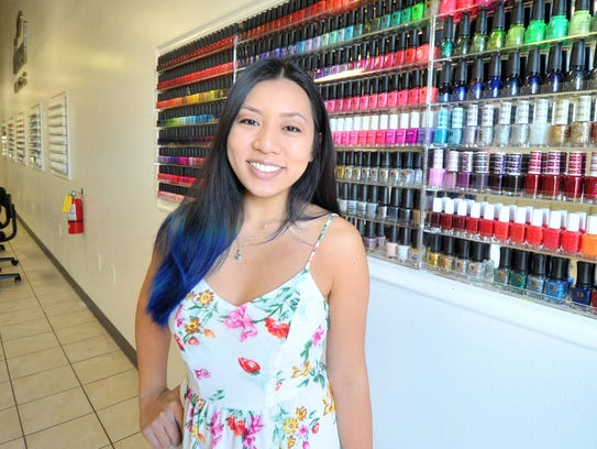 Owner Kathy Pham poses for a photo Friday at Diamond