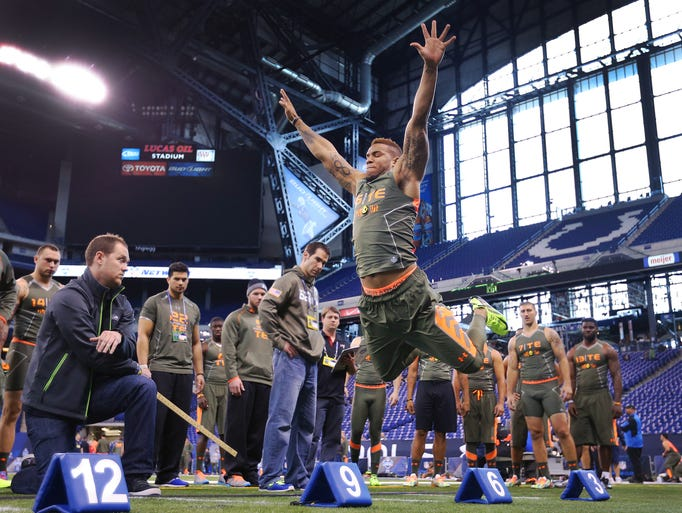 North Carolina TE Eric Ebron takes his leap at the broad jump during the first day of workouts Saturday afternoon during the NFL Scouting Combine at Lucas Oil Stadium.