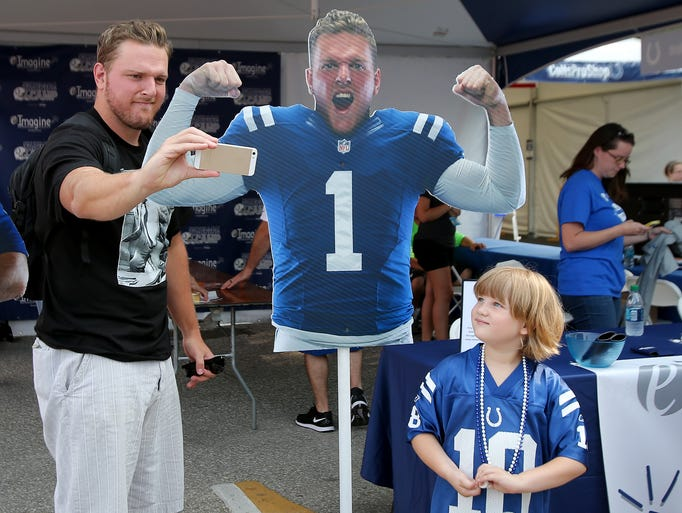 Indianapolis Colts punter Pat McAfee takes a selfie with himself as Brianna Martin, 6, looks on before the start of practice at training camp, on Thursday, July 31, 2014, in Anderson.