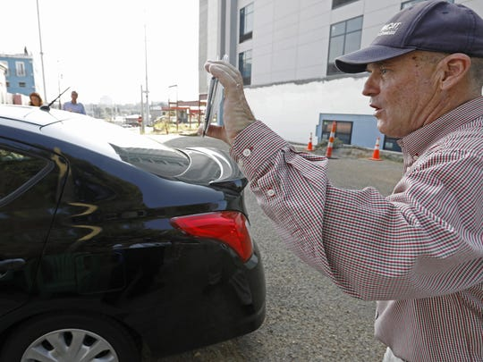 Anti-abortion activist Doug Lane calls out to a woman driving into the Jackson Women's Health Organization clinic in Jackson, Miss., on Oct. 2.