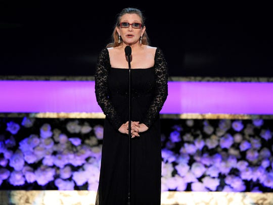 Carrie Fisher presents the life achievement award on
