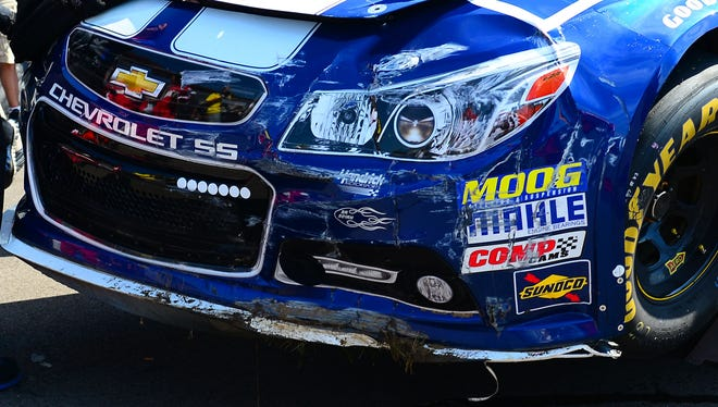 Jimmie Johnson's car leaks fluid after crashing during practice for the Pure Michigan 400 at Michigan International Speedway.