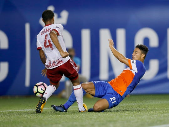 FC Cincinnati midfielder Marco Dominguez (21) is blocked