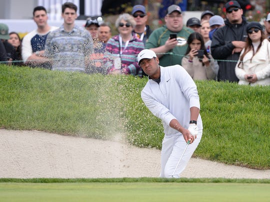 Jan 26, 2020; San Diego, California, USA; Tony Finau plays a shot from a bunker on the 18th hole during the final round of the Farmers Insurance Open golf tournament at Torrey Pines Municipal Golf Course - South Co. Mandatory Credit: Orlando Ramirez-USA TODAY Sports