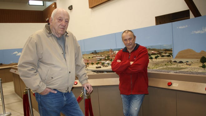 Phil Porter, left, and Willi Jung stand in front of the Little Old Carlsbad diorama they have built at the Carlsbad Museum and Art Center. The two men were named state Volunteers of the Year by the N.M. Association of Museums at its annual conference last week in Carlsbad.