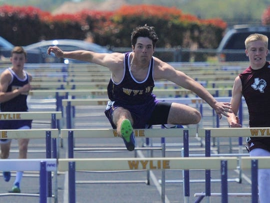 Wylie's Gatlin Martin goes over the next to last hurdle during the 110-meter hurdle finals at the District 5-4A meet at Bulldog Stadium on Thursday, April 5, 2018. Martin won the district title in the 110 and 300 hurdles.