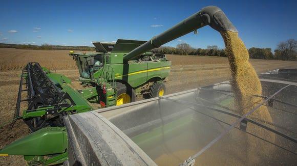 Howard Goodhue combines soybeans near Carlisle, Iowa, Tuesday, Oct 18, 2016.