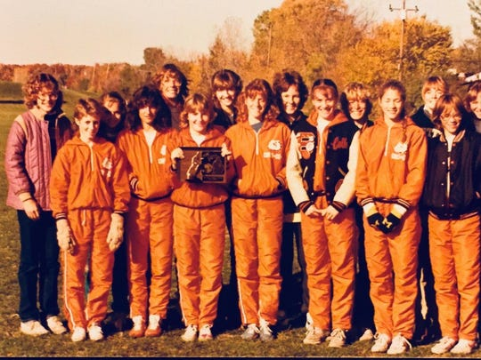 The 1983 Brighton girls' cross country team won the program's third state championship in five years.
