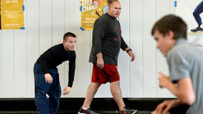 Asheville High alum Scott Buchanan is in the middle of his first season as the Cougars' wrestling coach.