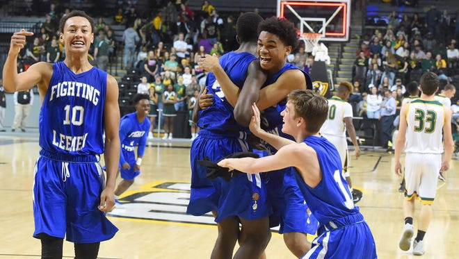 Robert E. Lee players celebrate as a team on the court as the clock hits zero and they defeat Amelia High School to win the Group 2A state championship in Richmond on Thursday, March 9, 2017.