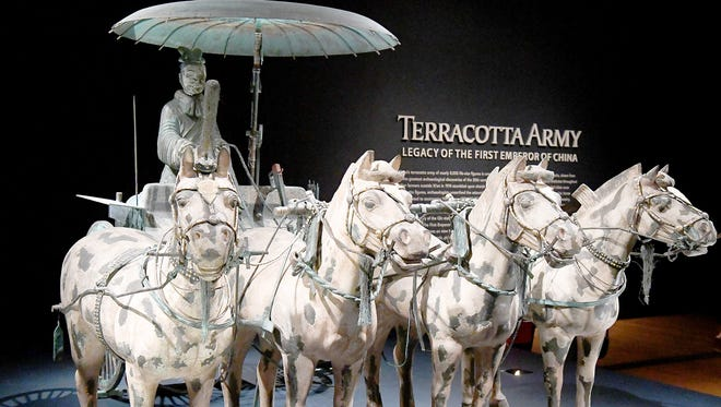 """""""Chariot No. 1 with Horses,"""" a replica bronze statue depicting four horses transporting a charioteer sitting beneath a parasol, greets visitors to the Terracotta Army exhibit on display at the Virginia Museum of Fine Art in Richmond on Saturday, Feb. 10, 2018."""