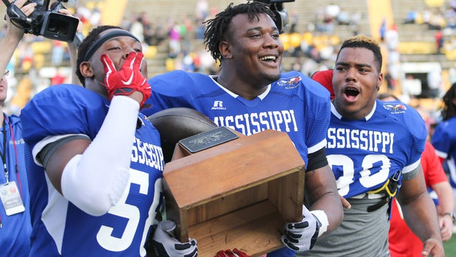 Starkville defensive tackle Kobe Jones (58), Meridian defensive tackle Raekwon Davis (93) and Noxubee County defensive end Jeffery Simmons (80) anchored Mississippi's defensive line in a 28-21 victory over Alabama on Saturday.