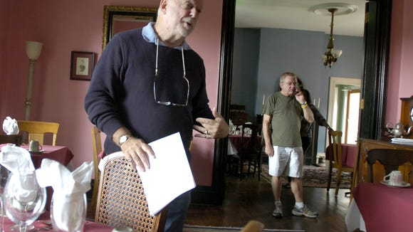 Michael Organ shows off the Bell Grae's dining facilities while Ken Hicks talks on the phone in the doorway in 2008.