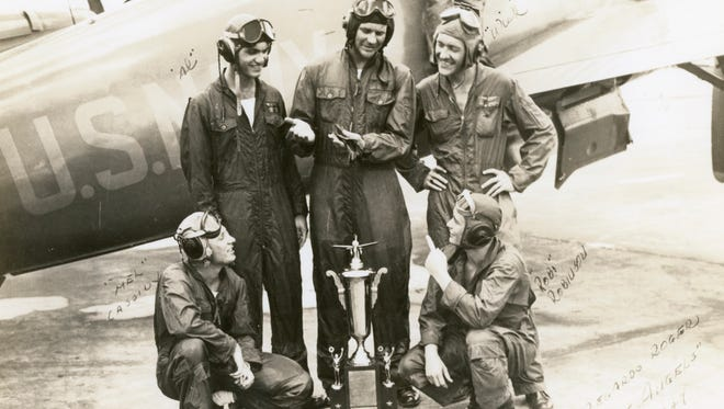 """The first Blue Angels team (clockwise from bottom left) Lt. Mel Cassidy,  Lt. Al Taddeo, Lt. Cmdr. """"Butch"""" Voris, Lt. Maurice Wickendoll,         and Ross """"Robi"""" Robinson in 1946. team: Lt. Al Taddeo, Lt. Gale Stouse, Lt. Cmdr. """"Butch"""" Voris, Lt. Maurice Wickendoll, and Lt. Mel Cassidy in 1946."""