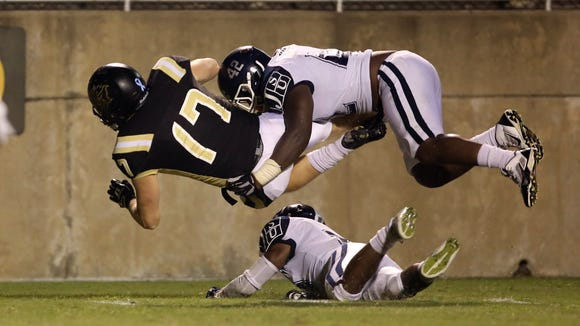 JSU linebacker Stacy Noble upends a UAPB running back, Saturday, September 27, 2014 in Pine Bluff, Ark. (Charles A. Smith/JSU Communications)