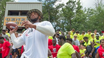 Tampa Bay tight end and former Alabama player O.J. Howard poses for a photo with Autauga Academy football players Saturday, June 16, 2018, during a football camp in Prattville, Ala.