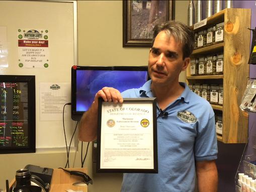 Denver-area marijuana store owner Mitch Woolhiser shows