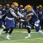 Patrick Henschen of New Cath hands the ball off to Jacob Smith.  Newport Catholic hosts Danville in the State Semi-finals played at Newport High School, Friday, November 27th, 2015.