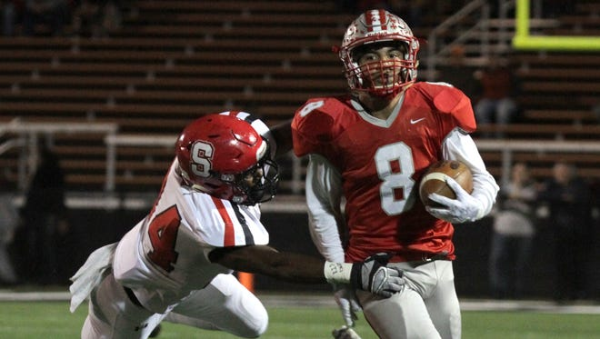 "Devon ""Shorty"" Brooks, evading a Steubenville defender is last year's playoffs, appears to be hitting his stride for the 11-0 Shelby Whippets."
