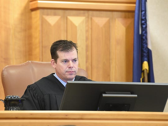 Eighth Judicial District Judge Gregory Lammons listens