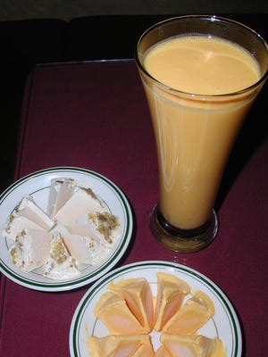 Sweet and cool Indian pistachio and mango ice creams go good on a hot day along with a tall glass of mango smoothie.