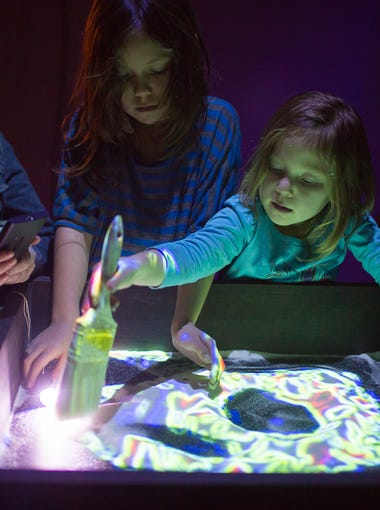 """Sandboxes of Life"" allows festivalgoers to ""paint"" with light in sand."