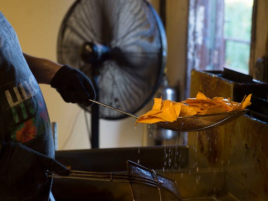 Jonathan Caban, of Stuart, fries sweet potato chips on Dec. 5, 2017, at the Old Florida Gourmet Product warehouse in Stuart. Old Florida's tortilla chips are GMO and gluten-free.