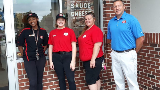 Marco's Pizza opened in Richmond Hill. From left, Bailey Harrison, Bailey Shumate, general manager Ashley Woolsey and co-owner Michael Allen.