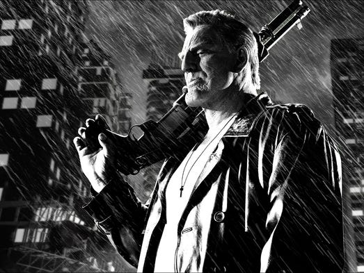"Mickey Rourke in a scene from, ""Sin City: A Dame to Kill For."""
