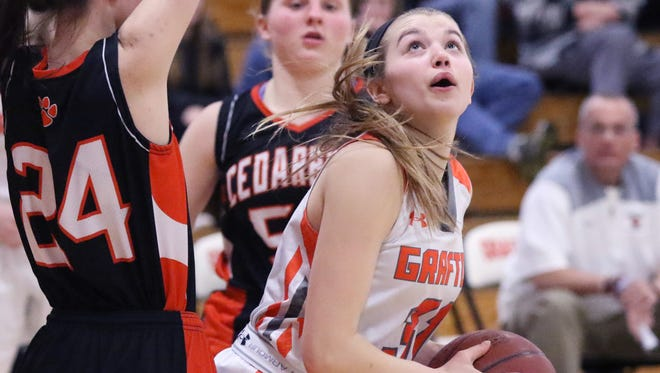Grafton's Sarah Schmitz looks to shoot for two points from beneath Cedarburg's Quinn Prom at Grafton on Feb. 9.