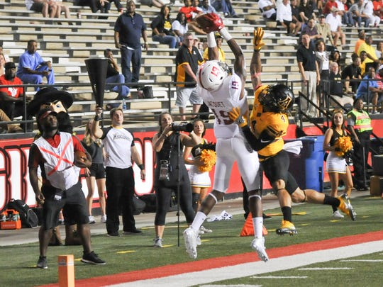 UL receiver Michael Jacquet, moving from wideout to the slot this year, goes high to make a catch against Appalachian State last season.