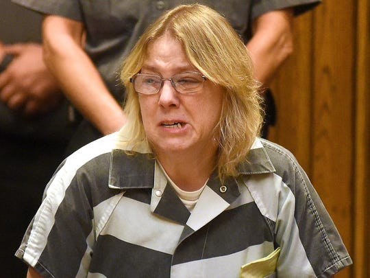 Joyce Mitchell cries in Clinton County Court, Monday, Sept. 28, 2015, in Plattsburgh, N.Y.
