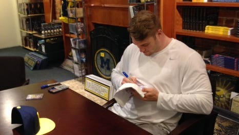 Former UM linebacker Jake Ryan signs autographs at the M Den Saturday. He is projected to go in the fourth or fifth round of the NFL draft.