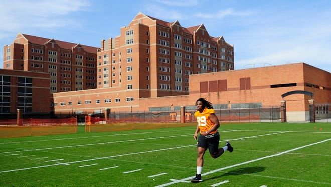 Kendal Vickers runs during Tennessee's football practice at Anderson Training Facility  on Thursday.