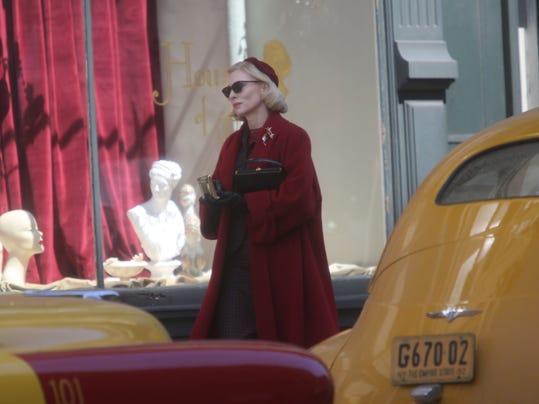 -Carol Cate walking by taxi.jpg