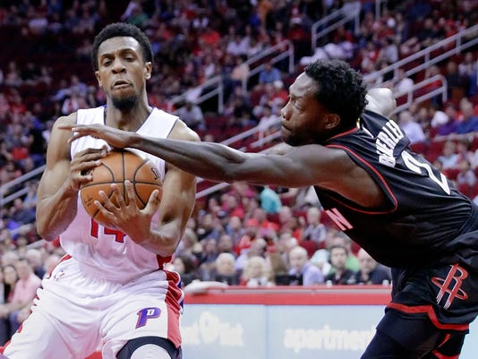 Detroit Pistons' Ish Smith (14) struggles to keep the ball as Houston Rockets' Patrick Beverley (2) defends first half of an NBA basketball game Friday, April 7, 2017, in Houston. (AP Photo/Michael Wyke)