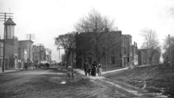 An early 20th century photo of Front Street, looking east towards Monroe's Old Village near where the 1915 Monroe Typhoid Fever Epidemic originated.