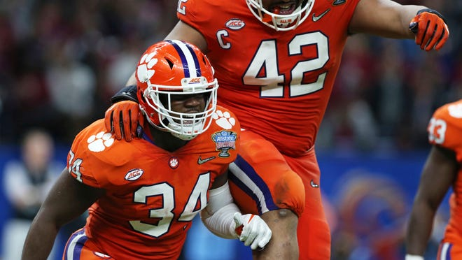 Clemson linebacker Kendall Joseph (34) and Christian Wilkins celebrate a fumble recovery in the second half of the Sugar Bowl semi-final playoff game against Alabama for the NCAA college football national championship, in New Orleans, Monday, Jan. 1, 2018. (AP Photo/Rusty Costanza)