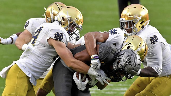 Pitt wide receiver Taysir Mack is gang tackled by Notre Dame defenders on Saturday, Oct. 24 in Pittsburgh.